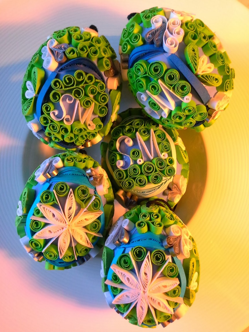 Blown eggs decorated in filigree quilling; green, blue, white and silver paper of various weights